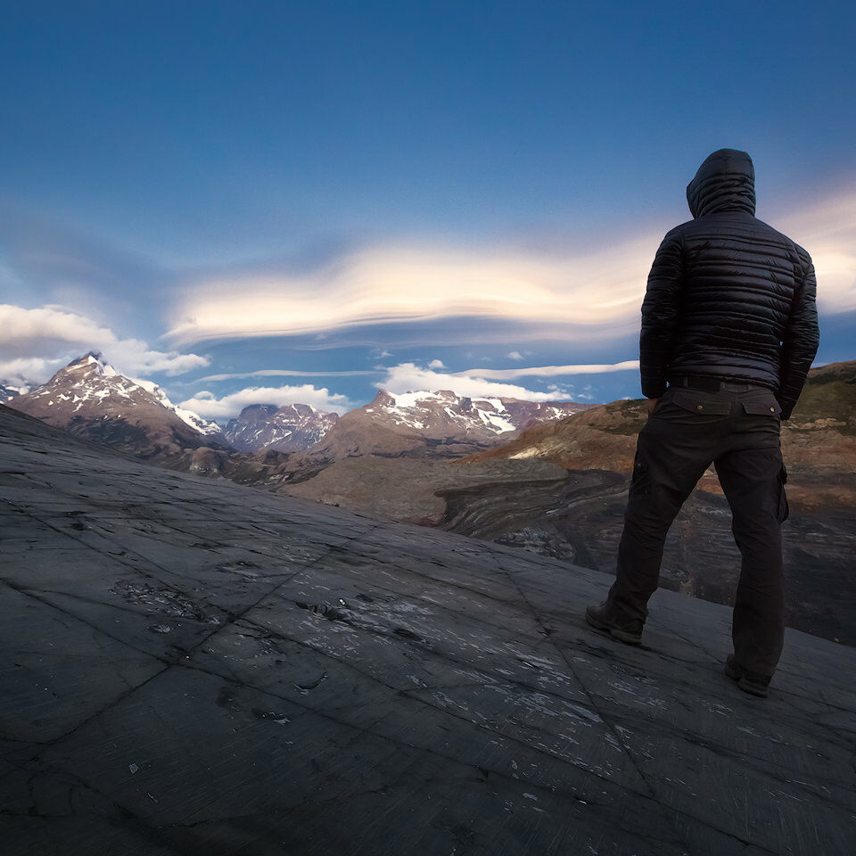 Joerg Bonner looking at mountains and a huge lenticular cloud.